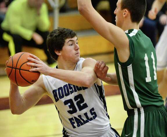 Hoosick Falls' #32 Mark Hackett, left, looks for a way around Shalmont's #11 Zac O'Dell during the Class B boys' basketball final at Colonie High School Saturday March 7, 2015 in Colonie, NY.  (John Carl D'Annibale / Times Union) Photo: John Carl D'Annibale / 00030907A