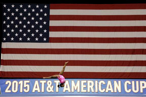 Simone Biles warms up before the American Cup gymnastics competition Saturday, March 7, 2015, in Arlington, Texas.
