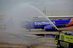 Fire trucks welcome Southwest Airlines' inaugural international flight arriving from Aruba to Houston William P. Hobby Airport Saturday, March 7, 2015, in Houston, Texas. This inaugural flight is the beginning of broader international service from Houston to destinations beyond the U.S. border. ( Gary Coronado / Houston Chronicle )