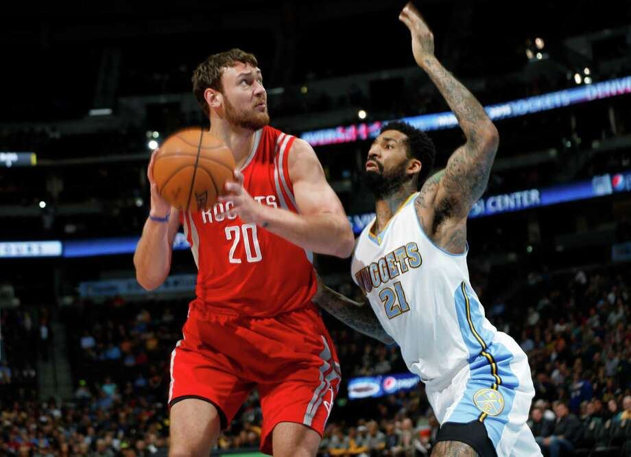 FILE - Houston Rockets forward Donatas Montiejunas, left, of Lithuania, looks for a shot in front of Denver Nuggets forward Wilson Chandler in the first quarter of an NBA basketball game Saturday, March 7, 2015, in Denver. Montiejunas was formally signed to the Spurs on April 4, 2019. Photo: David Zalubowski, Associated Press / AP
