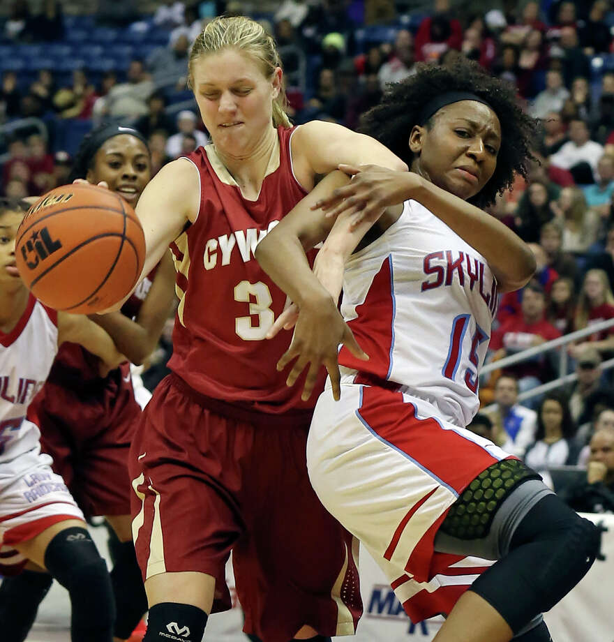 Cypress Woods' Cate Reese and Dallas Skyline's Jordan Alexander grab for a rebound during first half action of their UIL Class 6A Girl's Basketball State final held Saturday March 7, 2015 at the Alamodome. Photo: Edward A. Ornelas, San Antonio Express-News / © 2015 San Antonio Express-News