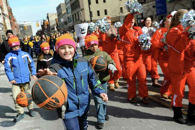 David Filkins, 8, of Altamont leads the parade as youngsters dribble basketballs down North Pearl Street to kick off the MAAC Tournament FanFest at the Times Union Center on Saturday, March 7, 2015, in Albany, N.Y. FanFest, sponsored by Dunkin' Donuts and Mazzone Hospitality, continues Sunday from 10 a.m. to 7 p.m. (Cindy Schultz / Times Union) Photo: Cindy Schultz / 00030915A