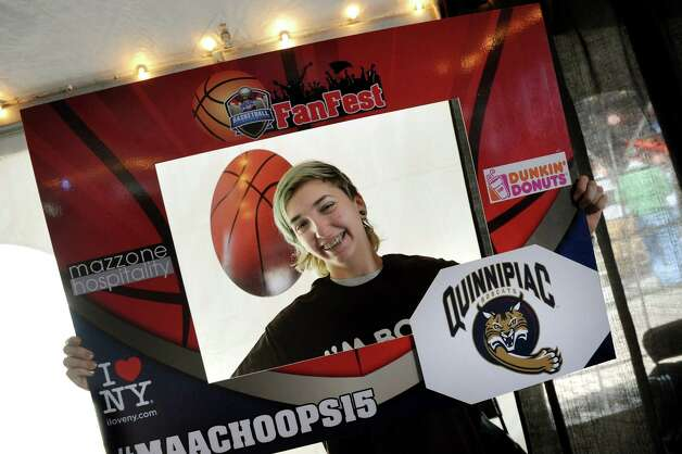 Ayla Goronkin, 16, of Ed Lewi and Assoc. poses with a picture frame during the launch of the MAAC Tournament FanFest at the Times Union Center on Saturday, March 7, 2015, in Albany, N.Y. FanFest, sponsored by Dunkin' Donuts and Mazzone Hospitality, continues Sunday from 10 a.m. to 7 p.m. (Cindy Schultz / Times Union) Photo: Cindy Schultz / 00030915A