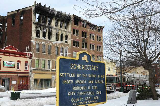 The Schenectady Fire Department continued to investigate the scene of a fire on Jay Street  Saturday March 7, 2015 in Schenectady, N.Y.  (Michael P. Farrell/Times Union) Photo: Michael P. Farrell / 00030929A