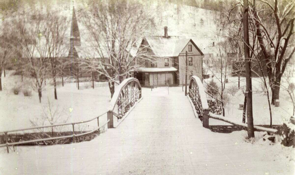 Flashback Bridge over the Shepaug Courtesy of Honey Stoeffler The old Green Hill Road (Route 47) bridge over the Shepaug River, leading into Washington Depot, is shown here in this circa 1930 photo on a cold and snowy morning. The photo looks toward the current location of Marty's Cafe. Back then, the buildings in this picture were, from left to right, the old town hall, the original Our Lady of Perpetual Help Catholic Church, the Engles house (later the A & P market, and Paul Gage's harness shop and home. The Washington History Club will meet Tuesday, March 17 at 6:30 p.m. in the Wykeham Room of Gunn Library. Those interested in the history of Washington, and the villages of New Preston, Marble Dale and Woodville, are welcome and may bring Washington pictures and objects for show and tell. The Gunn Library & Museum is located at 5 Wykeham Road. For more information, call 860-868-7756. Those who would like to loan or contribute a photo from any of the Greater New Milford-area towns should bring it to Norm Cummings at the Greater New Milford Spectrum office at 45B Main St. or email ncummings@newstimes.com. If the photo is to be returned, please leave a phone number and mailing address.