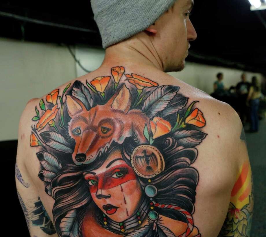 Tattoo extravaganza hits up houston san antonio express news for Tattoos of houston