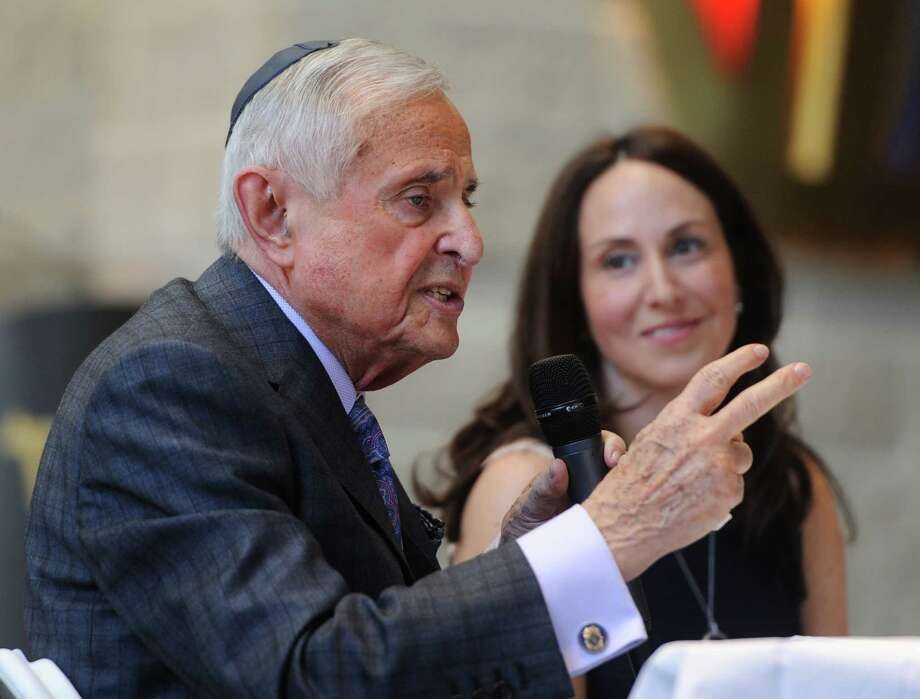 """Holocaust survivor Martin Greenfield speaks beside his niece Marla Felton in a program called """"An Intimate Discussion with Martin Greenfield - Auschwitz Survivor and an American Success Story"""" at Temple Sholom in Greenwich, Conn. Sunday, March 8, 2015.  Also known as America's greatest living tailor, Greenfield spoke about how the events he experienced in the Holocaust shaped his life.  Greenfield spoke with members of the temple and signed copies of his book, """"Measure of a Man: From Aushwitz Survivor to Presidents' Tailor,"""" following the formal presentation. Photo: Tyler Sizemore / Greenwich Time"""