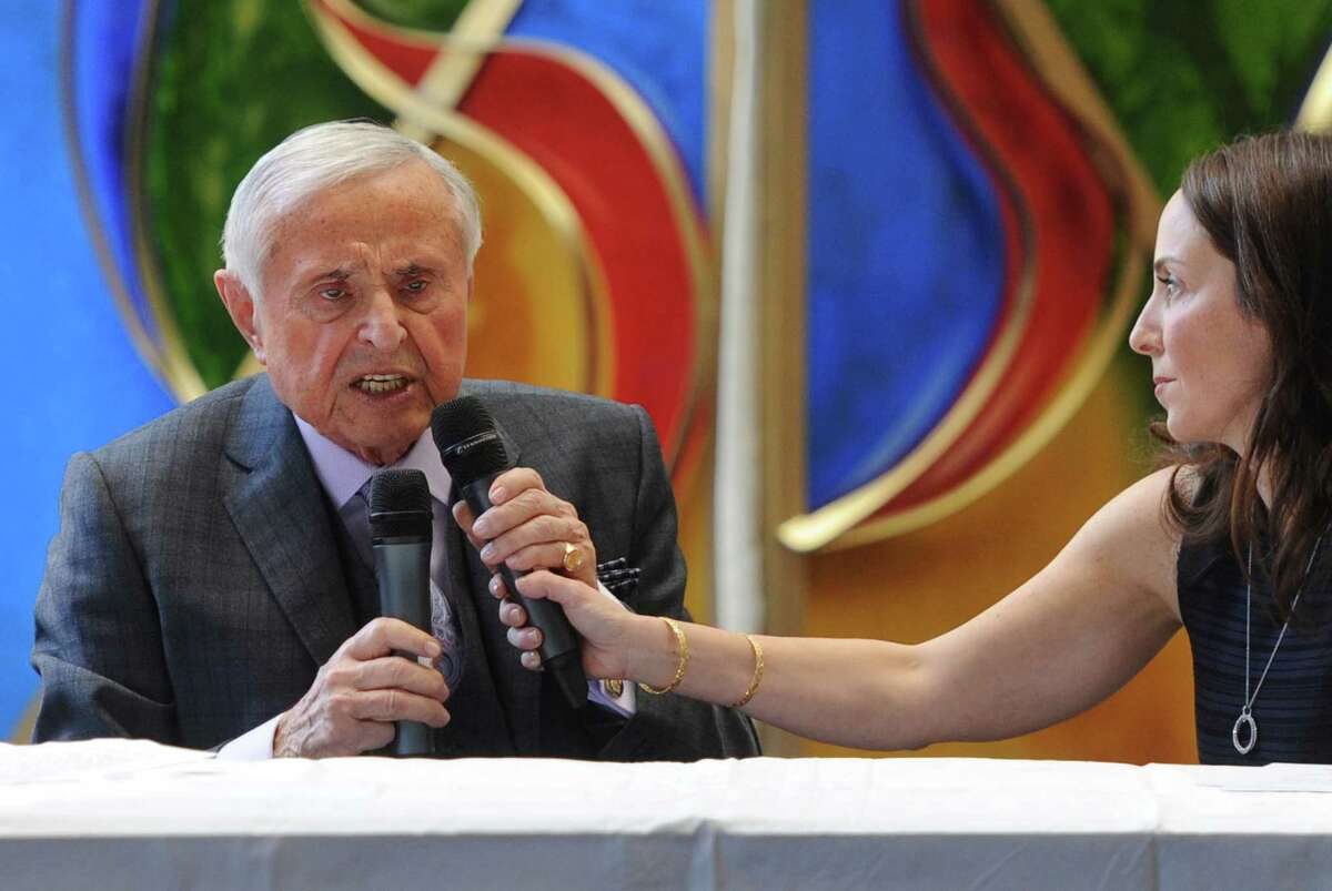 Holocaust survivor Martin Greenfield speaks beside his niece Marla Felton in a program called