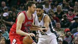 Chicago Bulls' Pau Gasol looks for room around San Antonio Spurs' Tim Duncan during first half action Sunday March 8, 2015 at the AT&T Center.