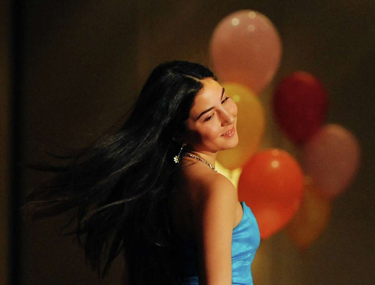Sarah Hammoud, 12, of Greenwich, flips her hair at the end of the runway during the
