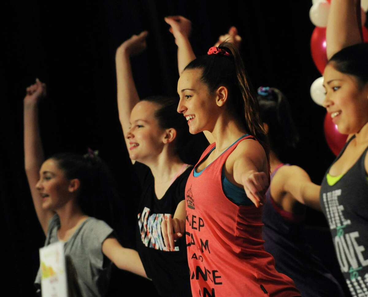 Julia Santarosa, center, and other dancers from the Greenwich Dance Studio perform a routine at the