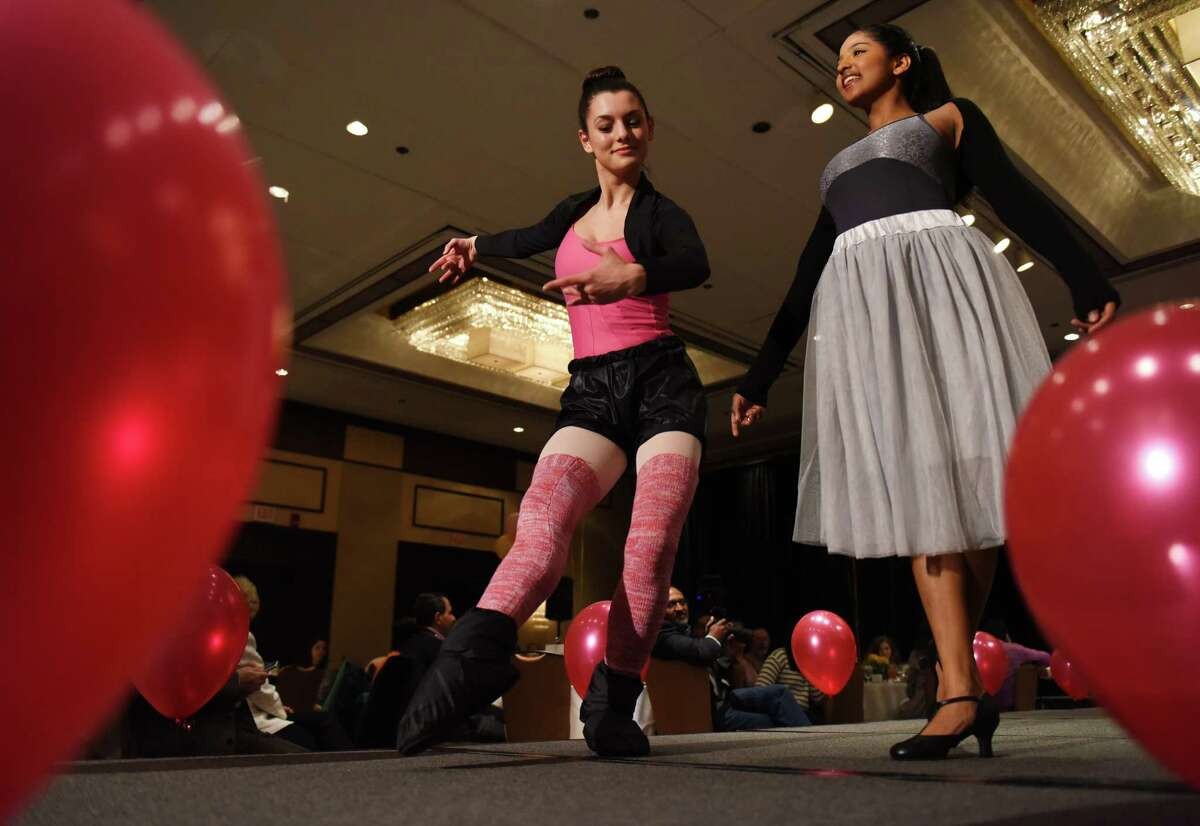 Emily Graffeo, left, 17, and Sadhana Shah, 17, walk the runway during the
