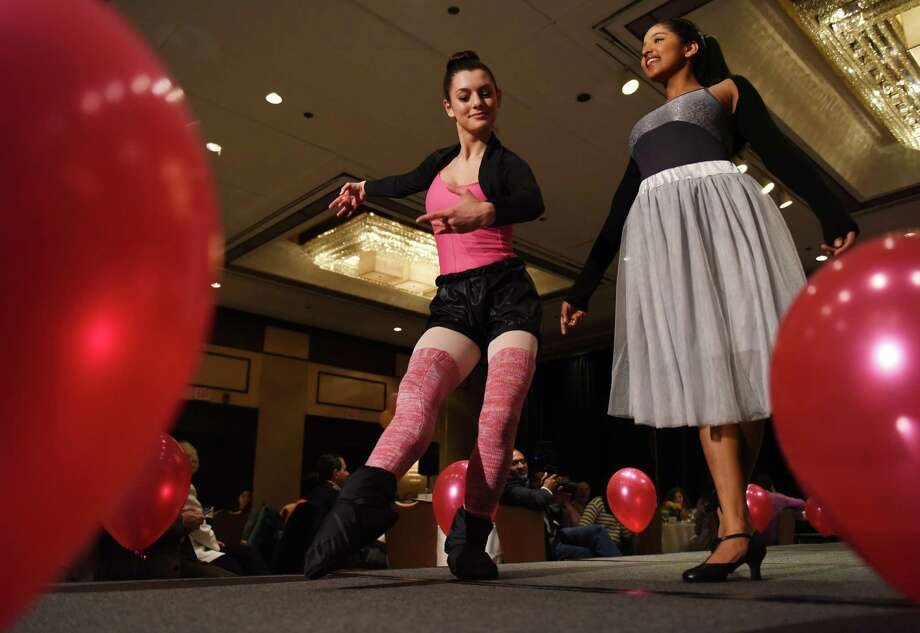 "Emily Graffeo, left, 17, and Sadhana Shah, 17, walk the runway during the ""Swing into Spring"" Fashion Show Fundraiser at the Hyatt Regency in Old Greenwich, Conn. Sunday, March 8, 2015.  The show, presented by Community Answers, featured a silent auction and luncheon followed by a runway show showcasing spring fashions from Beam and Barre, Lilly Pulitzer, Lord and Taylor, Stella M'Lia, Vilebrequin and Vineyard Vines. Photo: Tyler Sizemore / Greenwich Time"