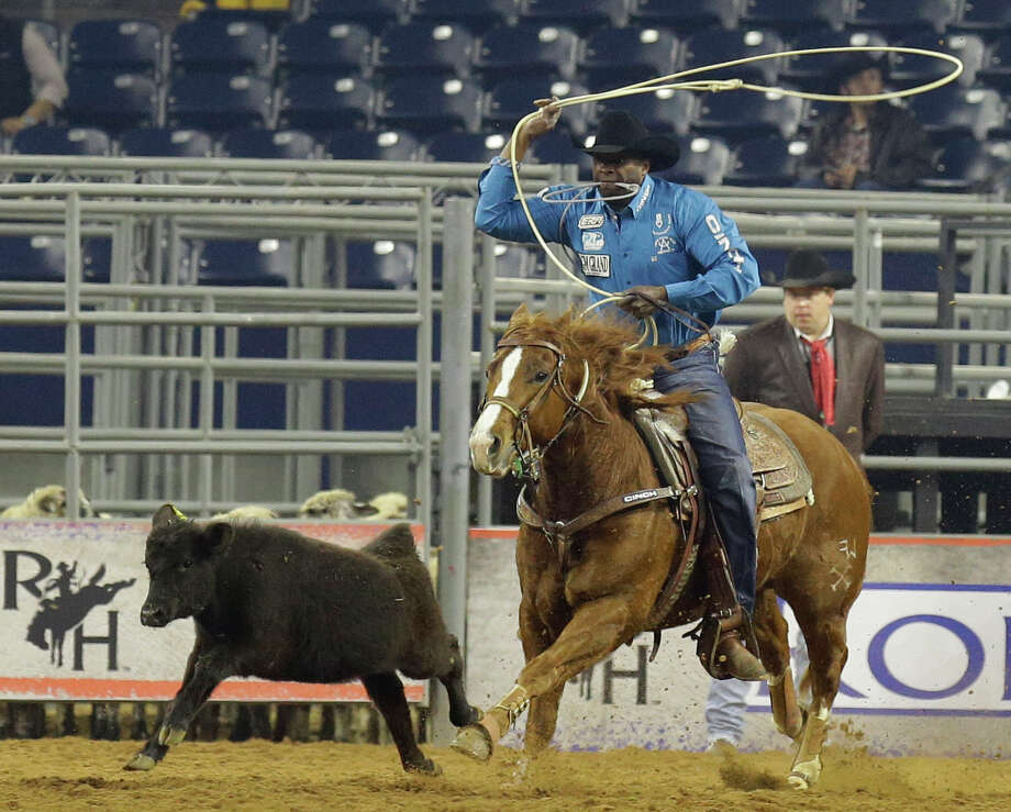 Fred Whitfield of Hockley competes in the tie-down roping event during RodeoHouston at the Houston Livestock Show and Rodeo in NRG Stadium Sunday, March 8, 2015, in Houston. Photo: Melissa Phillip, Houston Chronicle / © 2014  Houston Chronicle