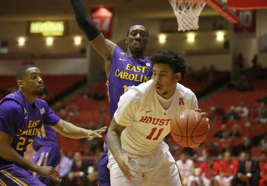 Houston Cougars forward J.C. Washington (11) dribbles against East Carolina Pirates guard Paris Roberts-Campbell (22) in the second half a NCAA mens basketball game at Hofheinz Pavilion on Sunday ,March 8, 2014 in Houston, TX. Houston won 72 to 54. Photo: Thomas B. Shea, For The Chronicle / © 2015 Thomas B. Shea