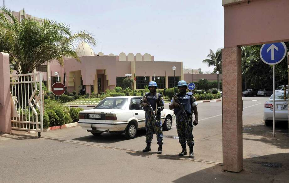 UN peacekeeper police officers stand guard at entrance of Hotel Salem in the capital Bamako, on March 8, 2015. Two civilians and a UN peacekeeper were killed as militants attacked a barracks used by the United Nations' MINUSMA force in northern Mali.  A MINUSMA source told AFP the civilian victims were members of the nomadic Arab Kunta tribe, which is spread across the Saharan regions of Mali, Algeria, Mauritania and Niger.  AFP PHOTO / HABIBOU KOUYATEHABIBOU KOUYATE/AFP/Getty Images Photo: HABIBOU KOUYATE, Stringer / AFP / Getty Images / AFP