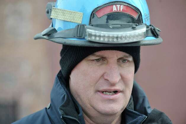 Dan Heenan, ATF National Response Team leader, talks about the process his team takes when on scene on Sunday, March 8, 2015, in Schenectady, N.Y. during an interview near the apartment buildings on Jay St. that were damaged by fire.   (Paul Buckowski / Times Union) Photo: PAUL BUCKOWSKI / 00030931A