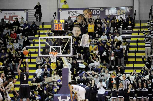 UAlbany fans try to distract Jacoby Armstrong of New Hampshire as he takes a foul shot during their America East semifinal game on Sunday, March 8, 2015, in Albany, N.Y.    (Paul Buckowski / Times Union) Photo: PAUL BUCKOWSKI / 00030901A
