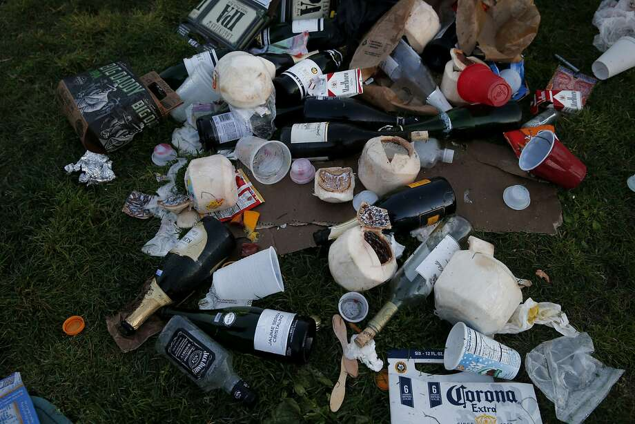 This party on the grass Saturday at Dolores Park had plenty of liquor options Sunday March 8, 2015. Dolores Park in San Francisco, Calif. has become a destination for many on a warm winter day, unfortunately the crowds leave a huge trash mess behind, especially on weekends. Photo: Brant Ward, The Chronicle