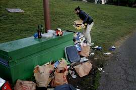 Members of a film crew cleaned up one area of the park so they could have a clean background Sunday March 8, 2015. Dolores Park in San Francisco, Calif. has become a destination for many on a warm winter day, unfortunately the crowds leave a huge trash mess behind, especially on weekends.