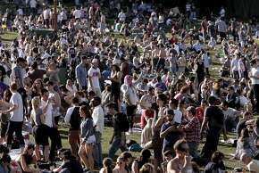 Warm temperatures jam pack visitors into Dolores Park in San Francisco, Ca. on Sat. March 7, 2015.