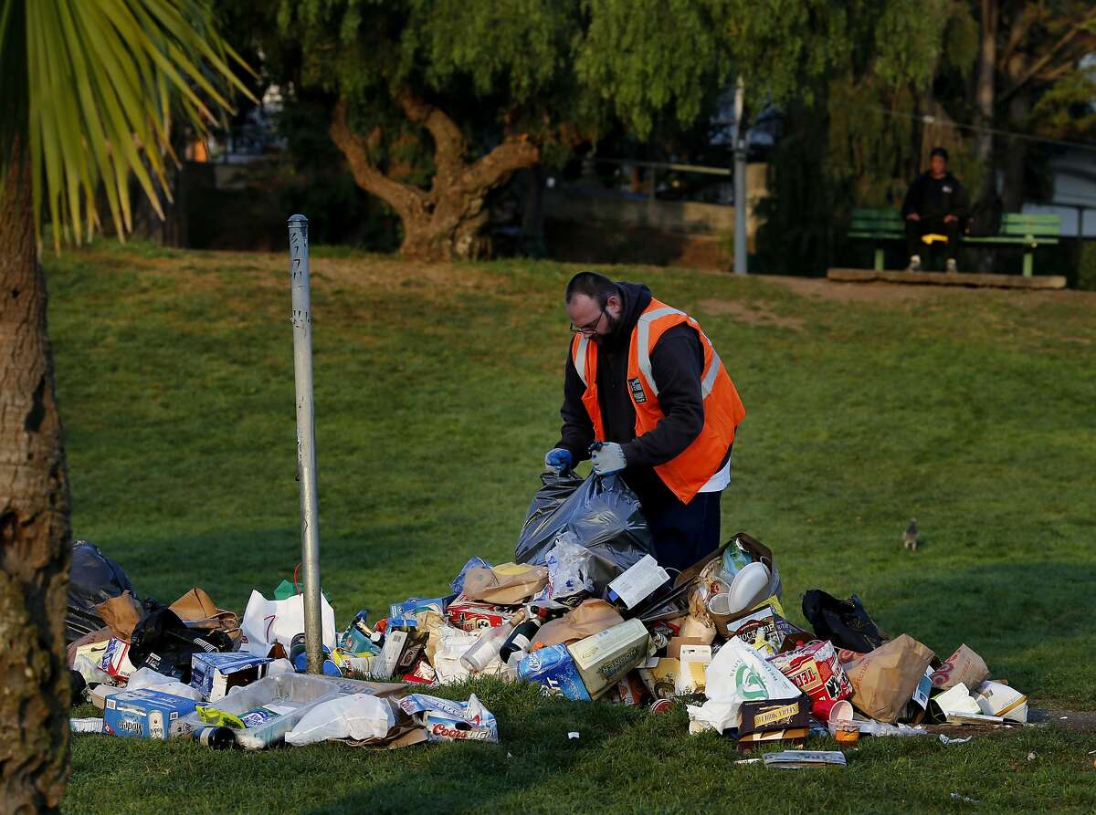 Park employees spend weekends cleaning up trash left behind from Saturday. Dolores Park in San Francisco, Calif. has become a destination for many on a warm winter day, unfortunately the crowds leave a huge trash mess behind, especially on weekends.