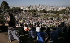 Visitors fill the hillsides to enjoy the unseasonably warm temperatures at Dolores Park in San Francisco, Ca. on Sat. March 7, 2015.