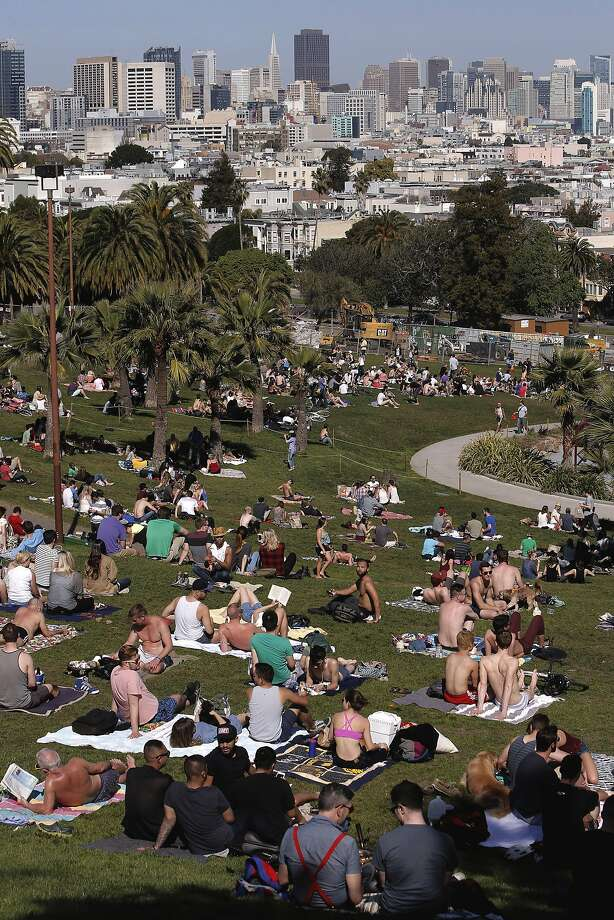 Saturday's warm, sunny weather draws visitors — and their trash — to Dolores Park. Photo: Michael Macor, The Chronicle