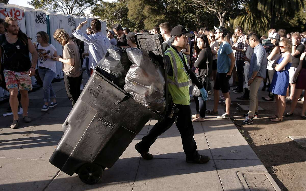 San Francisco Recreation and Parks custodian, Angelo Barreto empties park trash cans in the mid-afternoon to keep up with the trash disposal volume throughout Dolores Park in San Francisco, Ca. on Sat. March 7, 2015.