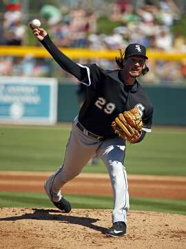 The White Sox' Jeff Samardzija threw three innings against the A's, then visited with them after he was done.