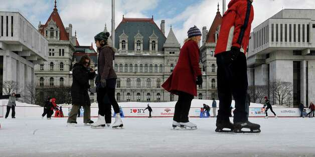Adults and children skate around on the ice rink at the Empire State Plaza on Sunday, March 8, 2015, in Albany, N.Y.  Sunday was the last day the ice rink was open for this season.   (Paul Buckowski / Times Union) Photo: PAUL BUCKOWSKI / 00030923A