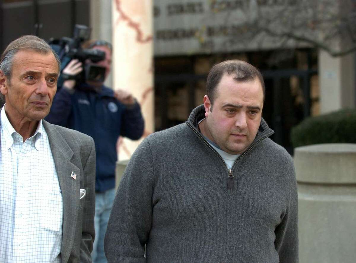 Congressman Christopher Shays' former campaign manager Michael Sohn, right, is seen leaving federal court in downtown Bridgeport, Conn. on Friday Dec. 04, 2009. At left is Michael's father Stephen. Michael Sohn has applied for permission to plead guilty on charges of embezzling campaign funds.