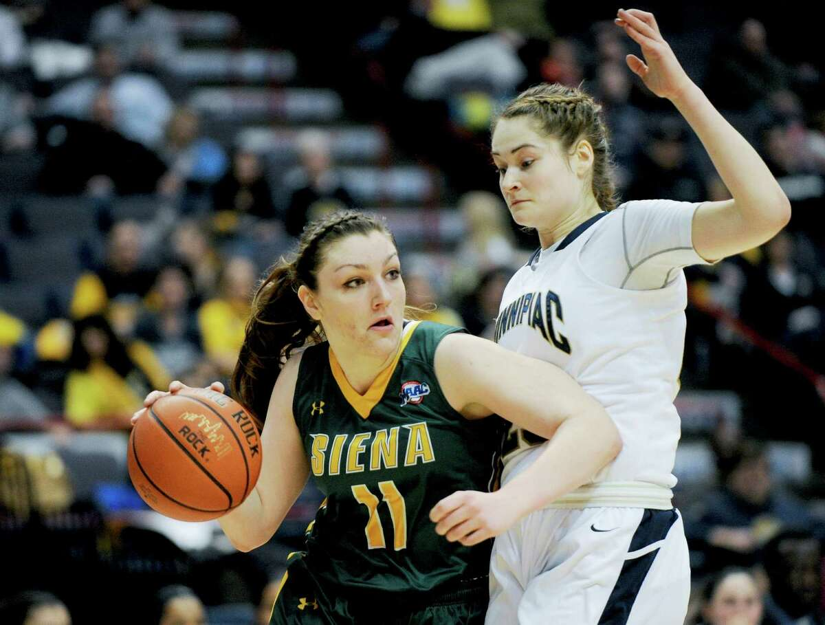 Siena's Margot Hetzke (11) moves the ball while being defended by Quinnipiac's Nikoline Osstergaard (23) during the semifinal game of the MAAC basketball tournament in Albany, N.Y., Sunday, March 8, 2015. (Hans Pennink / Special to the Times Union) ORG XMIT: HP102