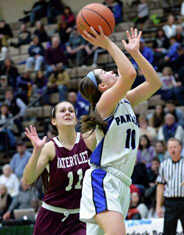 Hoosick Falls' #10 Rachel Pine, right, goes to the net past Watervliet's #11 Meghan Capone during the Class B girls' basketball final at  Hudson Valley Community College Saturday March 7, 2015 in Troy, NY. (John Carl D'Annibale / Times Union) Photo: John Carl D'Annibale / 10030883A