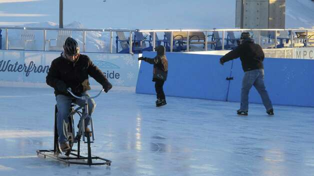 Dave Wolf of East Amherst, N.Y., tries out an ice bike at the Ice at Canalside in Buffalo, N.Y., Feb. 25, 2015. Wolf, who has Parkinson's disease, rides a three-wheel bike for exercise in warmer weather and likes the cold-weather alternative debuted by Ice Bikes of Buffalo in December. (AP Photo/Carolyn Thompson)                                ORG XMIT: RPCT204 Photo: Carolyn Thompson / AP