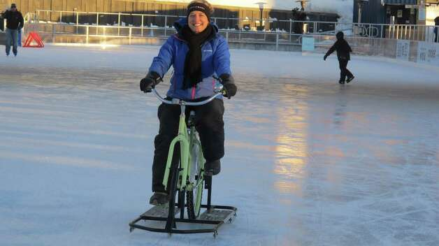 In a Feb. 25, 2015 photo, Lisa Florczak, founder of Ice Bikes of Buffalo, rides one of her inventions at the Ice at Canalside in Buffalo, N.Y., Feb. 25, 2015. Since the rental bikes debuted in December, Florczak has gotten inquiries from other cold-weather cities interested in rolling them out next year. (AP Photo/Carolyn Thompson) ORG XMIT: RPCT201 Photo: Carolyn Thompson / AP