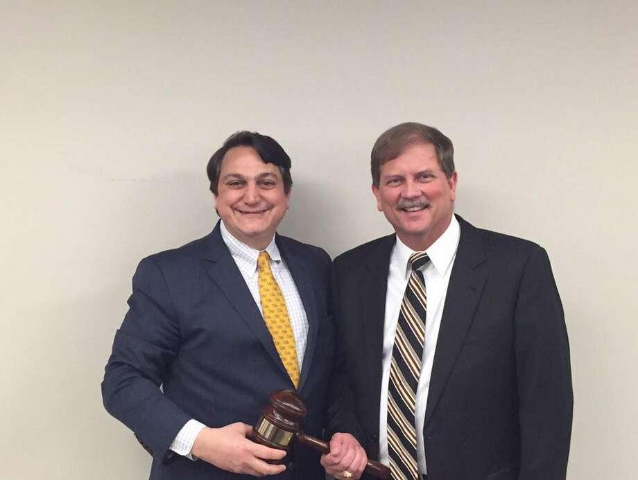 New Texas GOP chairman Tom Mechler, left, and outgoing chairman Steve Munisteri