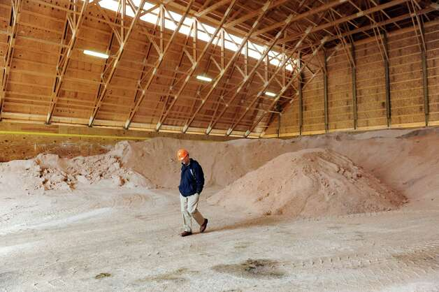 A DPW employee walks through the road salt storage shed on Wednesday, March 4, 2015, at Saratoga County Dept. of Public Works in Ballston Spa, N.Y. (Cindy Schultz / Times Union) Photo: Cindy Schultz / 10030845A