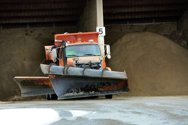 A DPW truck loads up with a hot mix of salt and sand on Wednesday, March 4, 2015, at Saratoga County Dept. of Public Works in Ballston Spa, N.Y. (Cindy Schultz / Times Union) Photo: Cindy Schultz / 10030845A