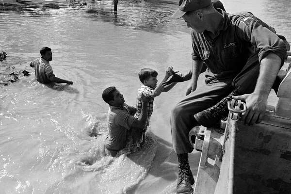 Ricky Knight, 13, is pulled from the floodwaters in the Parkwood Addition of Harlingen, flooded by the overflowing Arroyo Colorado in Harlingen on Sept. 25, 1967.