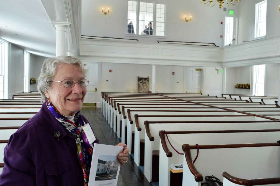Anne Patterson of Westport, a longtime member of Saugatuck Congregational Church, was emotional at Sunday's rededication service for the church, which had been closed after a 2011 fire. Photo: Jarret Liotta / Westport News
