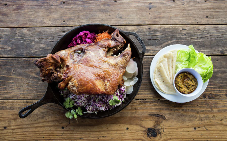 James Beard award-winning chef Chris Shepherd is adding family-style dishes to the menu at Hay Merchant. Half a Pig Head ($45) is a roasted pig head split down the middle, served with tortillas, lettuce cups, kimchi salsa and pickled vegetables. Serves 4-6 people. Photo: Julie Soefer