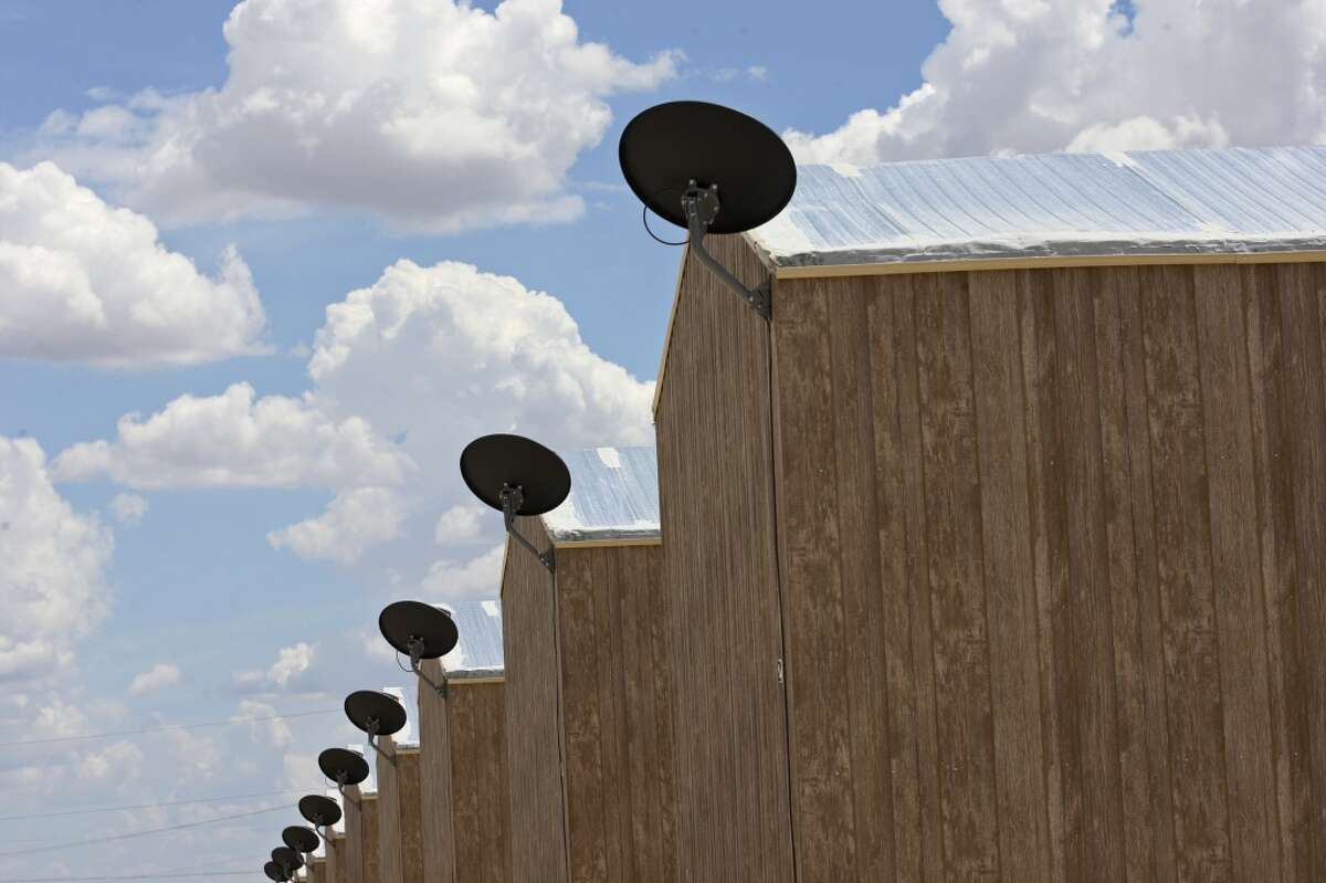 Satellite dishes are used on trailer homes at the Black Gold RV Park in Big Lake, Texas, Thursday, July 26, 2012. The trailers each house up to six workers. With the drilling boom in the area, a man-camp has opened just north of the town.