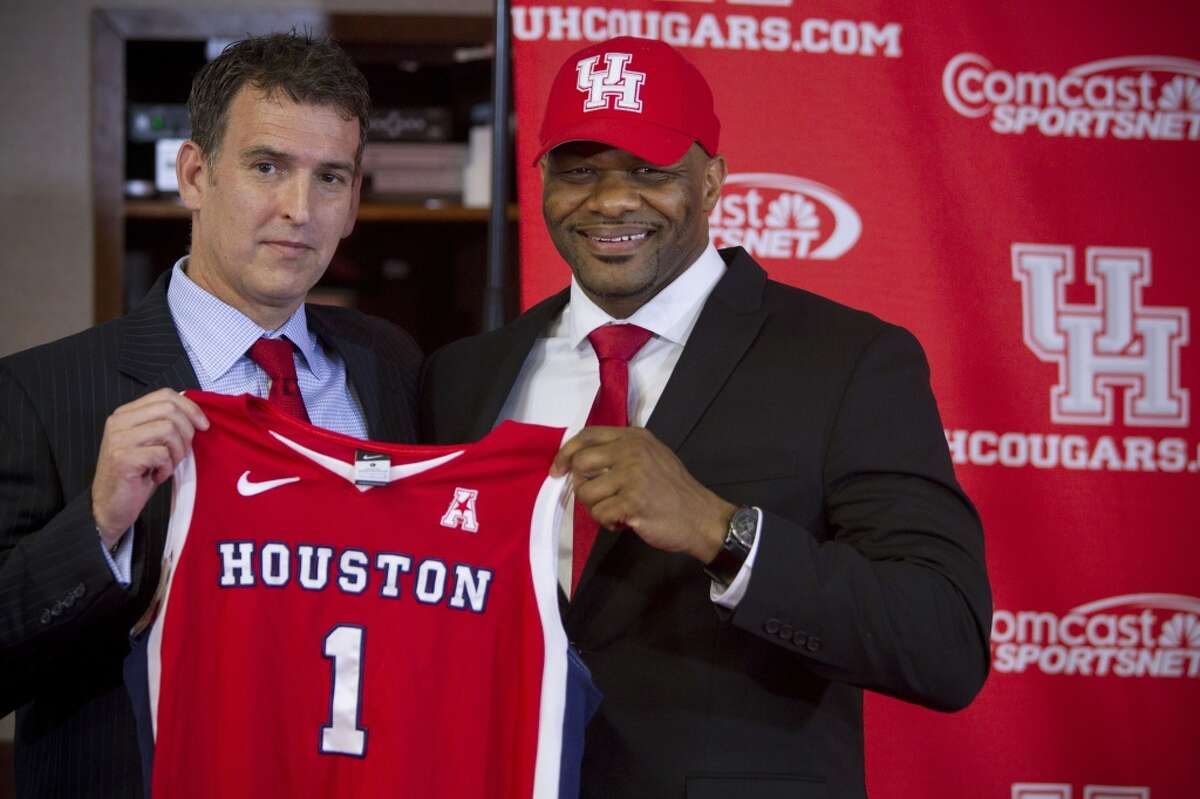 Mack Rhoades, vice president for Intercollegiate Athletics at the University of Houston, left, poses for photos with Ronald Hughey as Hughey is introduced at the new head women's basketball coach at UH during a news conference Tuesday, April 22, 2014, in Houston. ( Brett Coomer / Houston Chronicle )
