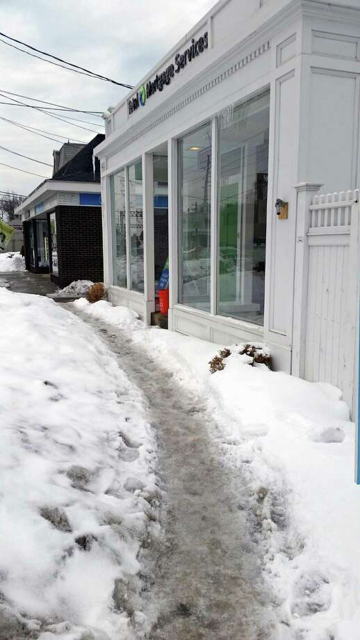 An icy sidewalk led to a $99 ticket for the owner of 1873 Post Road. Photo: Contributed Photo /  Fairfield Citizen contributed