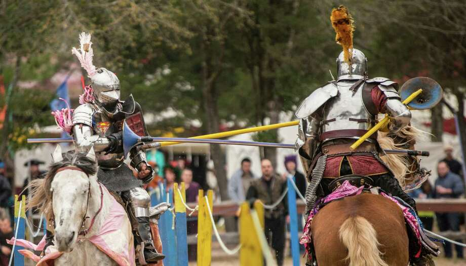 Eddie Rigney (left) of the Knights of Valour, clashes with Charlie Andrews (right) of the Knights of Mayhem, during a jousting tournament at Sherwood Forest Faire in McDade, Feb. 28, 2015. Photo by Joshua Trudell/For the Express-News Photo: /