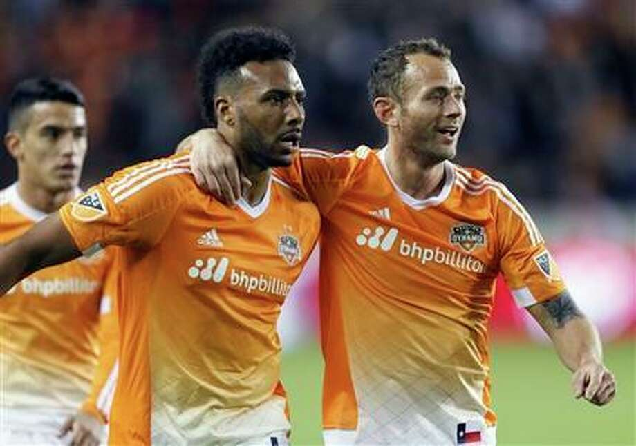 Giles Barnes and Brad Davis get ready to take on the Montreal Impact. Photo: Bob Levey, AP