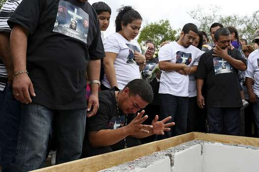 Juan Pablo Zapata grieves during the burial of his cousins, Erica Alvarado Rivera, 26, Alex Alvarado, 22, and Jose Angel Alvarado, 21, in El Control, Mexico on Sunday, November, 2, 2014. The siblings, U.S. citizens from Progreso, were found shot to death more than two weeks after they went missing from a restaurant near El Control. At right are the siblings' oldest brother, Pete Alvarado, and their father, Pedro Alvarado. Photo: Lisa Krantz