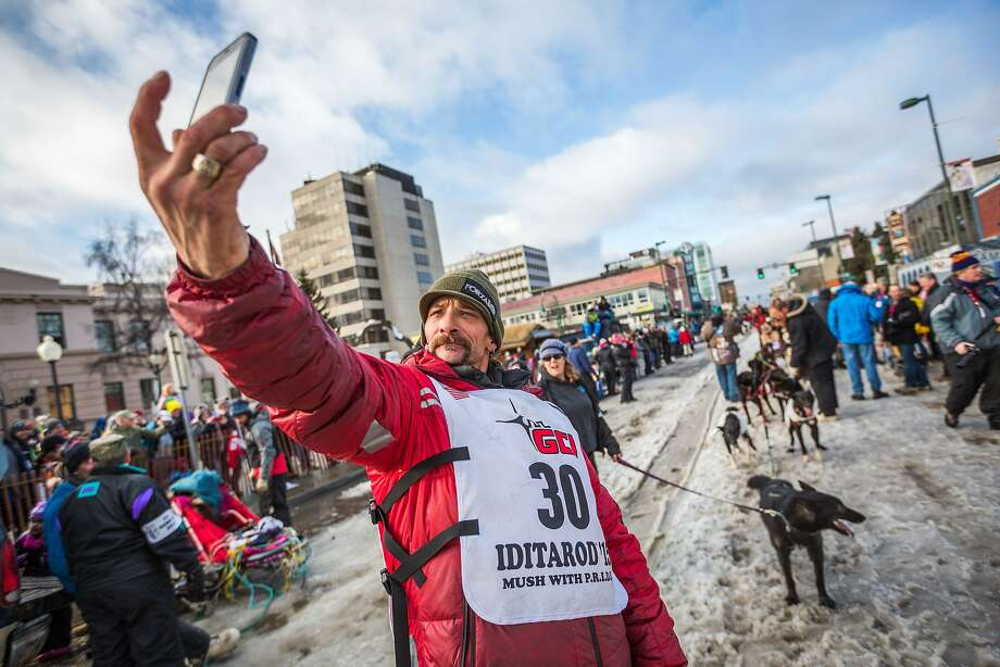 Musher Lance Mackey takes a selfie before the ceremonial start of the Iditarod sled dog race in Anchorage, Alaska, on Saturday, March 7, 2015. Mackey, a cancer survivor, is a 4-time champion. (AP Photo/Alaska Dispatch News, Loren Holmes)  KTUU-TV OUT; KTVA-TV OUT; THE MAT-SU VALLEY FRONTIERSMAN OUT Photo: Loren Holmes, Associated Press