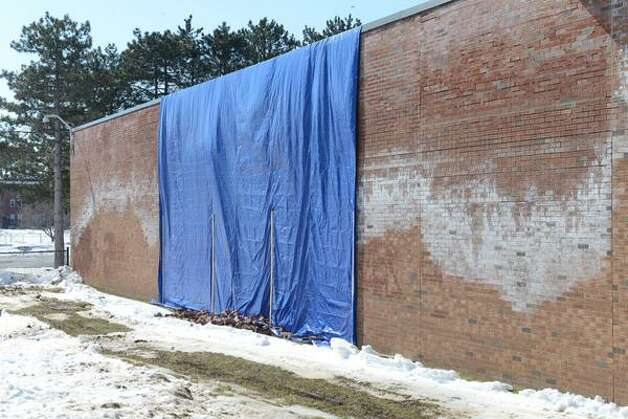 A section of bricks shown on Monday, March 9, 2015, fell last week from an exterior wall at Albany High School in Albany, NY. (Will Waldron/Times Union)
